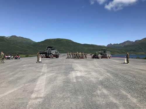 A ribbon cutting ceremony for the completion of the Innovative Readiness Training Old Harbor, Alaska, runway extension project was held August 7, 2018. Alaska Army National Guardsmen participated in the project for four of its six years. The Marine Corps was the lead service of the project, which incorporated service members from across all branches of the military. The Innovative Readiness Training program builds mutually beneficial civil-military partnerships between U.S. communities and the Department of Defense. (U.S. Army National Guard photo by Staff Sgt. Dayton G. Will)