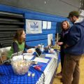 Alaska Sea Grant Marine Advisory agent Torie Baker speaks with fishermen in Cordova, Alaska, in 2015 about participating in a study about fishermen's health led by a University of Washington researcher Debra Cherry, MD. Image-ASG