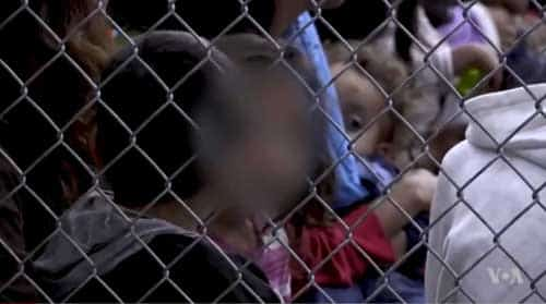 Children locked up in holding pens at border facility. Image-VOA