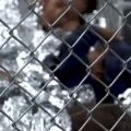 Children in space blankets locked up in child detention center. Image-Reuters video screenshot