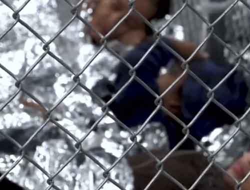 Children in space blankets locked up in child detention center. Image-Reuters video screenshot