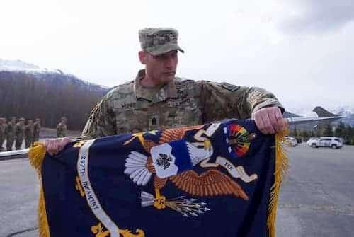 Alaska Army National Guard Command Sgt. Maj. Ryan Weimer, 1st Battalion, 297th Infantry Regiment, command sergeant major, cases the battalion colors. (U.S. Army National Guard photo by Sgt. David Bedard)