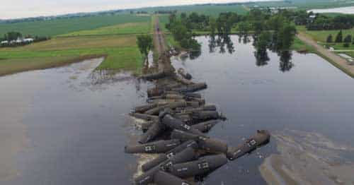 'We Don't Know… How Bad It Is': 31-Car Oil Train Derails Into Iowa Floodwaters
