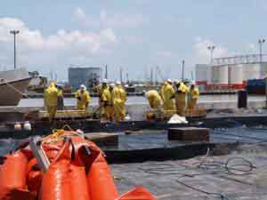 Cleanup workers in Venice, Louisiana, pressure washed oil booms to remove oil, debris, and dispersants. Image-James Remington, NIEHS