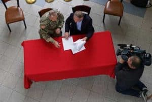 Col. Michael Brooks, commander of the Alaska District, U.S. Army Corps of Engineers, and Joe Balash, U.S. Department of the Interior's Assistant Secretary of Land and Minerals Management, sign the first joint record of decision nationwide between the Corps and the Bureau of Land Management for the Donlin Gold mine project. BLM Photo by Lisa Gleason