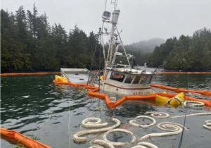 The 52-foot fishing vessel, Haida Lady, partially above the waterline near Sitka. U.S. Coast Guard photo by MSD Sitka personnel