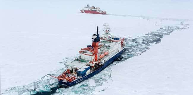 The USCGC Healy, hosting the US GEOTRACES expedition, and the RIB Polarstern, hosting the German GEOTRACES expedition, met at the North Pole on Sept. 7, 2015. A total of three GEOTRACES expeditions (the third a Canadian cruise on the CCGS Amundsen, not pictured) were conducted in the summer of 2015; this coordinated international effort will provide a more complete understanding of the chemistry of the Arctic Ocean as a whole. CREDIT- S. Hendricks