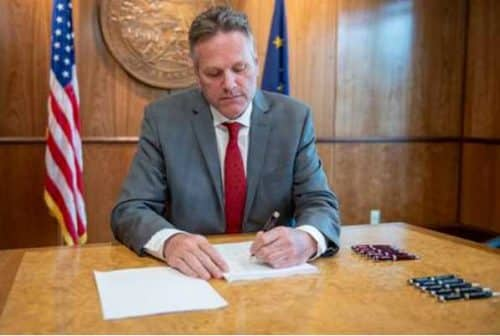 Governor Dunleavy signing the FY2020 budget. Office of the Governor