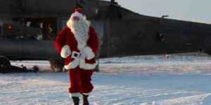 Santa arrives by air. Image-Department of Military and Veterans Affairs