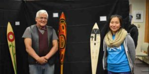 Wayne Price and student Kaytlynne Lewis pose with their paddles (credit: Davina Cole)