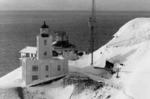 Scotch Cap Lighthouse sits on the southwest shore of Unimak Island two months before the giant wave of April 1, 1946. Photo courtesy National Oceanic and Atmospheric Administration's National Centers for Environmental Information, Coast Guard