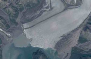 """A recent """"embayment"""" takes a bite out of the face of Hubbard Glacier. The feature may indicate the presence of a subglacial river. Image courtesy Mark Fahnestock"""