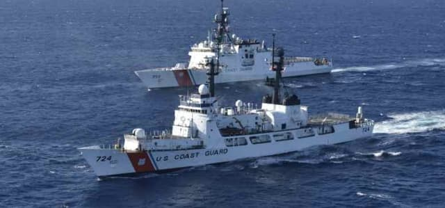 Coast Guard Cutter Douglas Munro (WHEC 724) and Coast Guard Cutter Munro (WMSL 755) patrol in the vicinity of the Hawaiian Islands alongside one another. U.S. Coast Guard courtesy photo.