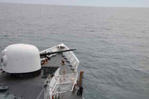Crewmembers aboard the Coast Guard Cutter Douglas Munro fire the ship's 76mm gun while on patrol in the Pacific Ocean. U.S. Coast Guard courtesy photo.