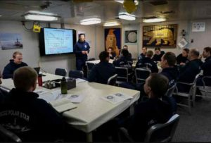 Lt. Cmdr. Andrew Jantzen, the operations officer aboard the Coast Guard Cutter Polar Star (WAGB 10), holds ice pilot training in the cutter's wardroom Monday, December 14, 2020 while underway in the Bering Sea. U.S. Coast Guard Photo by Petty Officer 1st Class Cynthia Oldham