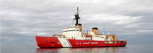 The Seattle-based Coast Guard Cutter Polar Star is at anchor in Puget Sound Monday, December 7, 2020 ahead of the crew's months-long deployment to the Arctic. The 44-year-old heavy icebreaker will project power and support national security objectives throughout Alaskan waters and into the Arctic, including along the Maritime Boundary Line between the United States and Russia. U.S. Coast Guard Photo by Petty Officer First Class Cynthia Oldham.