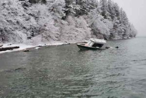 A beached vessel is anchored to the shoreline in Barlow Cove, about 15 miles northwest of Juneau.  (U.S. Coast Guard photo by Cutter Bailey Barco)