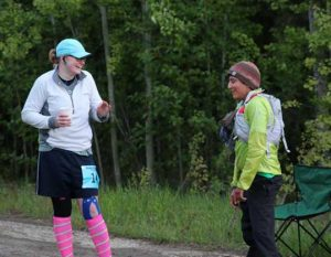 Laura Southwell of Anchorage and Carmen Klooster of Fairbanks take a break after completing a six-mile lap in the Alaska Endurance Trail Run, held on the UAF campus. Photo by Chris Carlson.