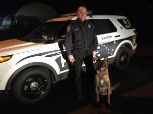 """K9 """"Kenai"""" and his handler, APD K9 Officer Scott Huston. Image-APD"""