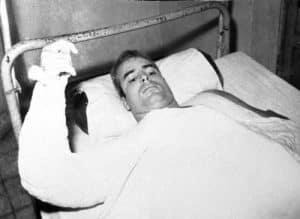 U.S. Navy Lt. Cmdr. John S. McCain lies injured in North Vietnam wearing an arm cast, in this undated photo.