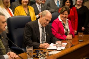 "Governor Walker signing SB23, dubbed the ""Overdose Prevention Bill,"" into law. Image-State of Alaska"