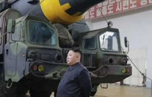 North Korean president Kim Jong Un in front of missile at undisclosed location. Image-KRT screengrab