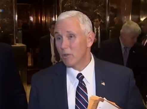 Vice President-Elect Mike Pence talking to reporters on President-Elect Trump's new hires to top posts. Image-VOA