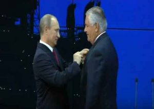 Trump's Secretary of State pick, Rex Tillerson, receiving medal from Russian President Vladimir Putin. Image-Screengrab Exxon Mobile video