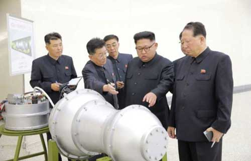 North Korean leader Kim Jong Un, center, provides guidance on a nuclear weapons program in this undated photo released by North Korea's Korean Central News Agency (KCNA)