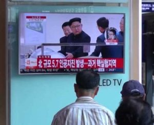 Korean viewers watching footage of Kim Jong Un inspecting what is said to be a nuclear device. Image-VOA