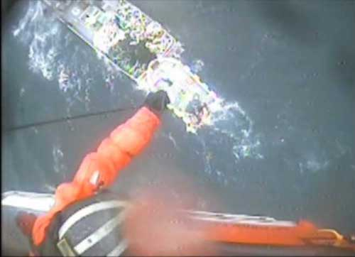 USCG Jayhawk hoist a surviving crew,member from Good Samaritan vessel. Image-USCG