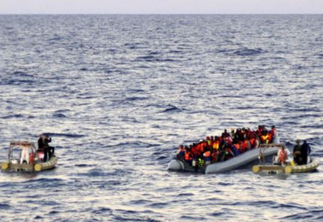 Italian Navy personnel contacting migrants 40 miles off the coast of Libya. Image-Italian Navy