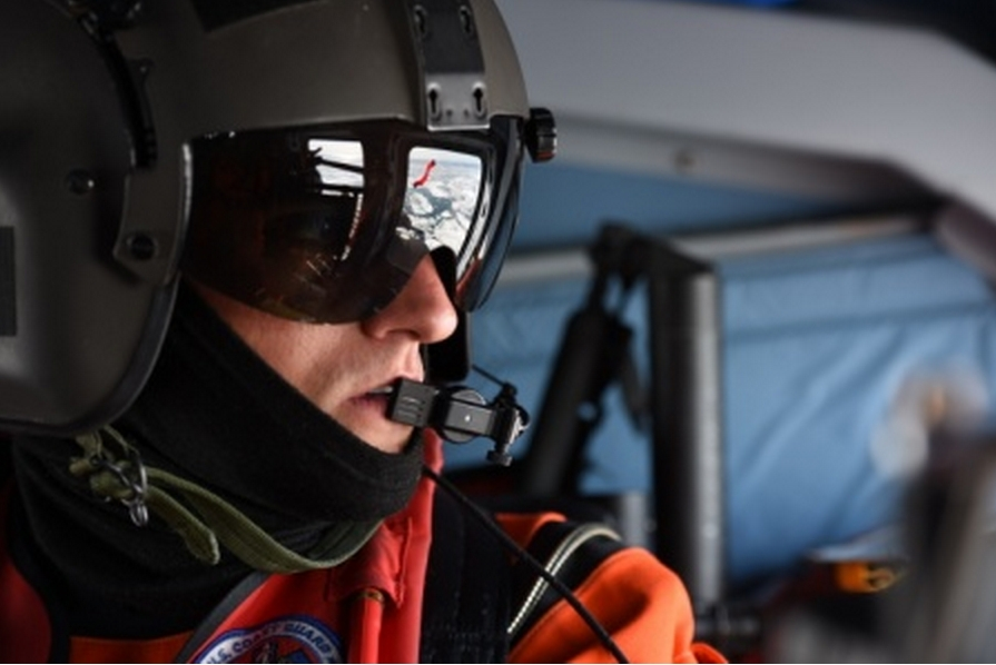 Petty Officer 2nd Class Darren Hicks, an aviation survival technician at Coast Guard Air Station Kodiak, looks out over Arctic sea ice during a search and rescue exercise near Oliktok Point, Alaska, July 13, 2015. (U.S. Coast Guard photo by Petty Officer 2nd Class Grant DeVuyst)