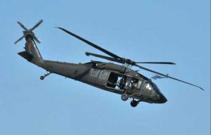 A U.S. Army UH-60 Blackhawk helicopter, similar to the one pictured here crashed into the sea two miles west of Kaena Point, Oahu with five crew aboard. Image U.S. Army