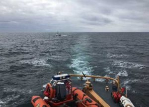 The crew of the Coast Guard Cutter Naushon tows four mariners after the Soulmate, their 48-foot commercial fishing vessel, became disabled and adrift approximately 57 miles west of Kodiak Island. Image-USCG