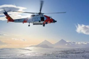 A U.S. Coast Guard MH-60 Jayhawk helicopter assigned to Air Station Kodiak flies over an active volcano near Cold Bay. (U.S. Coast Guard photo by Petty Officer 1st Class Bradley Pigage)