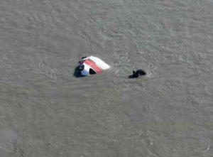 Poelman's Cessna 207 submerged at Big Susitna crashsite. Image-AST