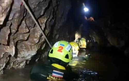 Rescuers decend innto cave for final time to rescue last of trapped soccer team and coach. Image-VOA video screenshot