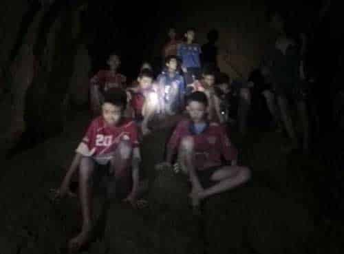This July 2, 2018, photo released by Tham Luang Rescue Operation Center, shows the boys and their soccer coach as they were found in a partially flooded cave, in Mae Sai, Chiang Rai, Thailand