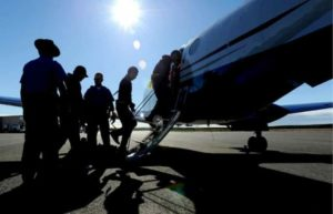 Alaska State Troopers load prisoners onto a DPS King Air aircraft in Kotzebue in 2016. Image-DPS