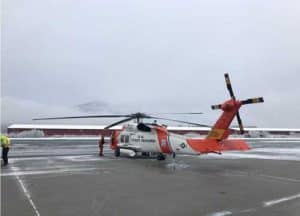 A Coast Guard Air Station Sitka MH-60 Jayhawk helicopter aircrew rescues two stranded miners on the Chilkat River, 23 miles from Haines, Alaska, Nov. 3. U.S. Coast Guard photo by Lt. Kellen Browne.