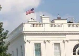After an uproar across the nation, the White House flag was returned to half-mast. Image-Steve Herman